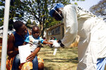 A health worker attends to a child suffering from cholera symptoms at a local hospital in Harare, Tuesday, Sept, 11, 2018.  A cholera emergency has been declared in Zimbabwe's capital after 20 people have died, the health minister said Tuesday. (AP Photo/Tsvangirayi Mukwazhi)