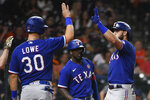 Texas Rangers' Joey Gallo, right, celebrates his three-run home run with Nate Lowe (30) during the eighth inning of a baseball game against the Houston Astros, Saturday, May 15, 2021, in Houston. (AP Photo/Eric Christian Smith)