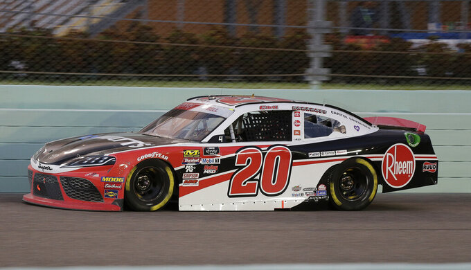 Christopher Bell leads during the NASCAR Xfinity Series auto race on Saturday, Nov. 16, 2019, at Homestead-Miami Speedway in Homestead, Fla. (AP Photo/Terry Renna)