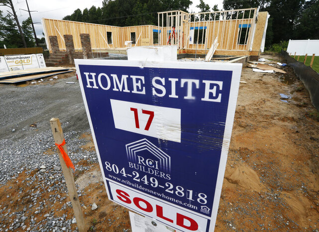 FILE - In this June 13, 2019, photo a new home is under construction in Mechanicsville, Va. On Monday, Dec. 23, The Commerce Department reports on sales of new homes in November. (AP Photo/Steve Helber, File)