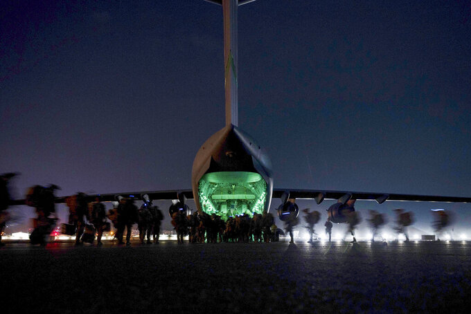 FILE - In this Aug. 30, 2021, file photo provided by the U.S. Air Force, soldiers, assigned to the 82nd Airborne Division, prepare to board a U.S. Air Force C-17 Globemaster III aircraft at Hamid Karzai International Airport in Kabul, Afghanistan. (Senior Airman Taylor Crul/U.S. Air Force via AP, File)