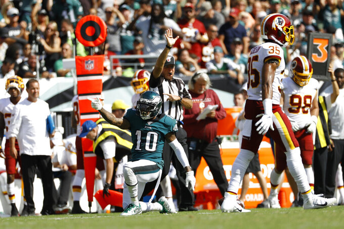 Philadelphia Eagles' DeSean Jackson (10) reacts after making a first-down catch during the second half of an NFL football game against the Washington Redskins, Sunday, Sept. 8, 2019, in Philadelphia. (AP Photo/Michael Perez)