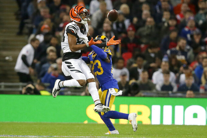 Cincinnati Bengals wide receiver Tyler Boyd, left, catches a pass against Los Angeles Rams defensive back Nickell Robey-Coleman during the first half of an NFL football game, Sunday, Oct. 27, 2019, at Wembley Stadium in London. (AP Photo/Tim Ireland)