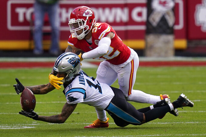 Carolina Panthers wide receiver Robby Anderson (11) cannot catch a pass while defended by Kansas City Chiefs strong safety Tyrann Mathieu (32) during the first half of an NFL football game in Kansas City, Mo., Sunday, Nov. 8, 2020. (AP Photo/Orlin Wagner)