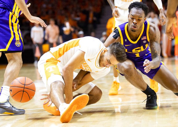 Tennessee guard Santiago Vescovi (25) and LSU guard Javonte Smart (1) go after a loose ball during an NCAA college basketball game at Thompson-Boling Arena, Saturday, Jan. 4, 2020,  Knoxville, Tenn. (Brianna Paciorka//Knoxville News Sentinel via AP)