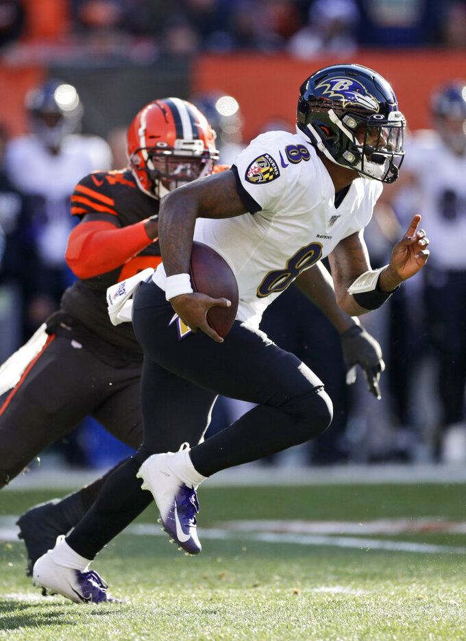 Baltimore Ravens quarterback Lamar Jackson rushes against the Cleveland Browns during the first half of an NFL football game, Sunday, Dec. 22, 2019, in Cleveland. (AP Photo/Ron Schwane)