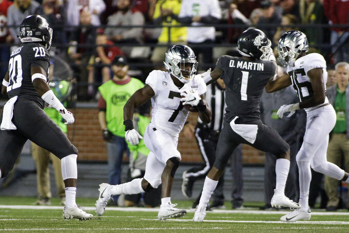 Oregon safety Ugochukwu Amadi (7) returns a punt during the second half of an NCAA college football game against Washington State in Pullman, Wash., Saturday, Oct. 20, 2018. Washington State won 34-20. (AP Photo/Young Kwak)