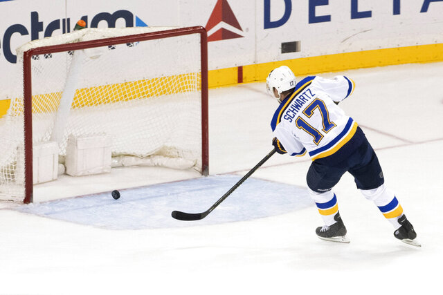 St. Louis Blues left wing Jaden Schwartz scores a goal on an empty net during final seconds of the third period of an NHL hockey game against the New York Rangers, Tuesday, March 3, 2020, at Madison Square Garden in New York. The Blues won 3-1. (AP Photo/Mary Altaffer)