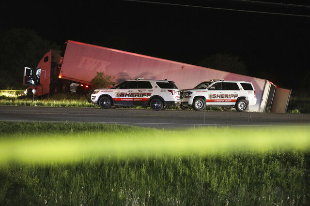 Livingston County Sheriff's work at the scene of cab of a tractor trailer after the driver was killed during a shootout with law enforcement officers, Thursday, May 28, 2020 on Rt. 20A in Geneseo, N.Y. The incident started in LeRoy, N.Y. when police stopped the tractor trailer for speeding but the driver took off and drove into Livingston County leading law enforcement on a chase. (Tina MacIntyre-Yee/Democrat & Chronicle via AP)