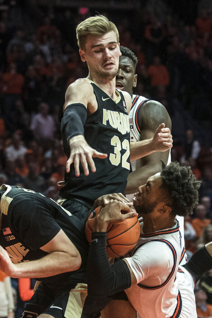 Illinois' Alan Griffin (0) holds on to the ball as he is pressured by Purdue's Matt Harms (32) in the first half of an NCAA college basketball game, Sunday, Jan. 5, 2020, in Champaign, Ill. (AP Photo/Holly Hart)