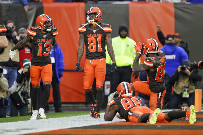 Cleveland Browns wide receiver Rashard Higgins (81) celebrates with teammates after scoring a 7-yard touchdown during the second half of an NFL football game against the Buffalo Bills, Sunday, Nov. 10, 2019, in Cleveland. (AP Photo/Ron Schwane)