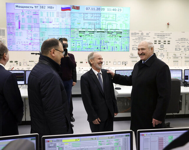 Belarusian President Alexander Lukashenko, right, attends the first Belarusian Nuclear Power Plant during the plant's power launch event outside the city of Astravets, Belarus, Saturday, Nov. 7, 2020. Alexander Lukashenko on Saturday formally opened the country's first nuclear power plant, a project sharply criticized by neighboring Lithuania. Lukashenko said the launch of the Russian-built and -financed Astravyets plant