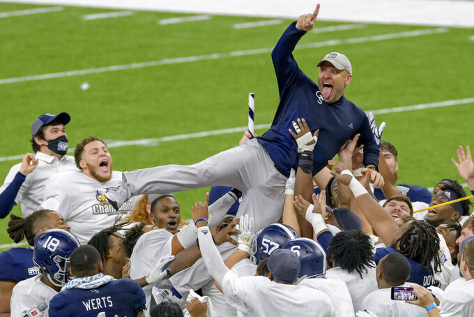 Georgia Southern coach Chad Lunsford and players celebrate the team's victory over Louisiana Tech in the New Orleans Bowl NCAA college football game in New Orleans, Wednesday, Dec. 23, 2020. (AP Photo/Matthew Hinton)