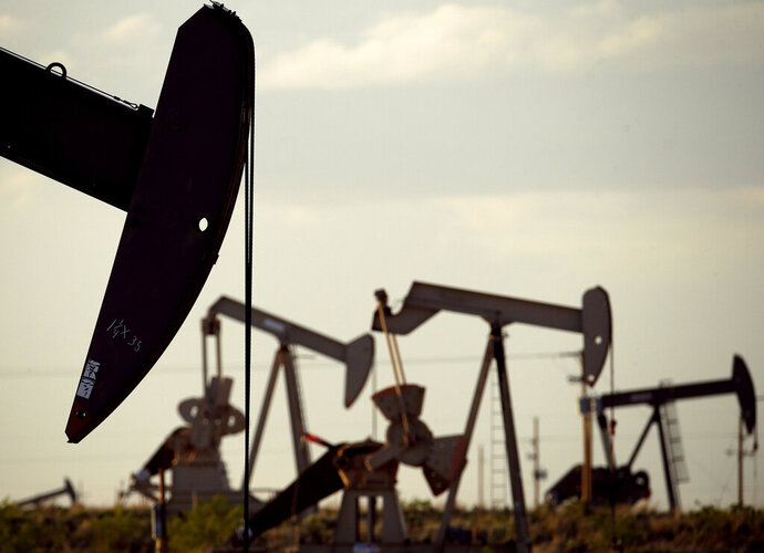 FILE - In this April 24, 2015, file photo, pumpjacks work in a field near Lovington, N.M. Two New Mexico counties remain among the top oil-producing counties in the U.S., according to new federal numbers released in May 2019. (AP Photo/Charlie Riedel, File)