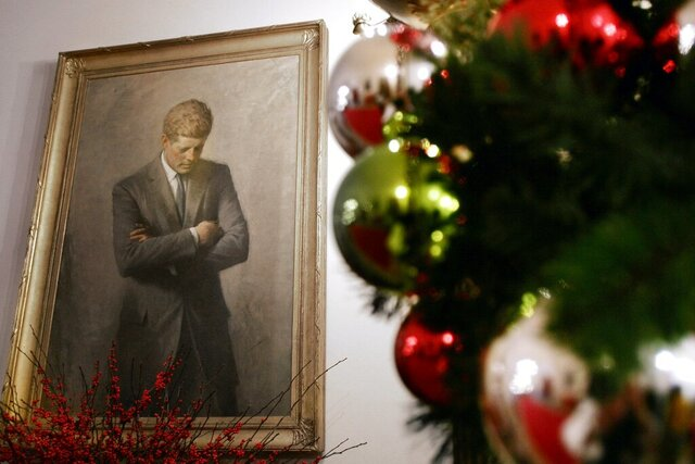FILE - In this Nov. 30, 2006, file photo, a portrait of former President John F. Kennedy, framed by Christmas decorations, hangs in the White House in Washington. A copy of Kennedy's 1961 letter reassuring an 8-year-old Michigan girl, who had written him concerned that Santa would be killed if Russia tested a nuclear bomb at the North Pole, is being featured in December 2019 at the JFK Presidential Library and Museum in Boston. (AP Photo/Ron Edmonds, File)