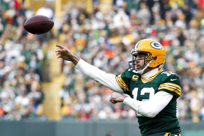Green Bay Packers' Aaron Rodgers throws during the first half of an NFL football game against the Washington Redskins Sunday, Dec. 8, 2019, in Green Bay, Wis. (AP Photo/Matt Ludtke)