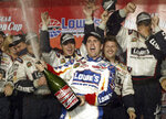 FILE - In this May 17, 2003, file photo, Jimmie Johnson, center, celebrates with his crew in victory lane after winning The Winston, NASCAR's all-star race, in Concord, N.C. Seven-time NASCAR champion Jimmie Johnson says 2020 will be his final season of full-time racing. The winningest driver of his era will have a 19th season in the No. 48 Chevrolet and once again chase a record eighth championship. Johnson made the announcement in a video posted on social media, Wednesday, Nov. 20, 2019.(AP Photo/Chuck Burton, File)