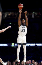 United States' Donovan Mitchell attempts a shot during their exhibition basketball game against Australia in Melbourne, Thursday, Aug. 22, 2019. (AP Photo/Andy Brownbill)