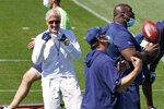 Seattle Seahawks head coach Pete Carroll, left, looks on with coaches Sunday, Aug. 30, 2020, during an NFL football training camp in Renton, Wash. (AP Photo/Elaine Thompson)