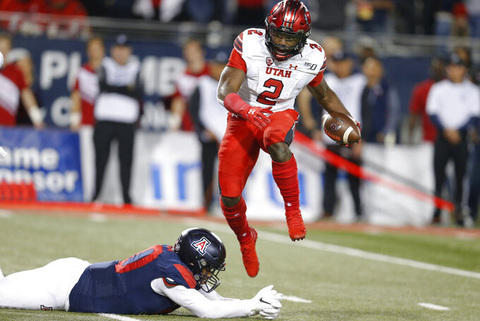 Moss leads No. 7 Utah to 35-7 victory over Arizona