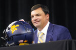 FILE  - West Virginia head football coach Neal Brown smiles as he listens to a question during NCAA college football Big 12 media days Wednesday, July 14, 2021, in Arlington, Texas. West Virginia went 6-4 a year ago and will need improvements, especially on offense, in order to challenge for a Big 12 title this season. The Mountaineers open the season Sept. 4 at Maryland. (AP Photo/LM Otero)