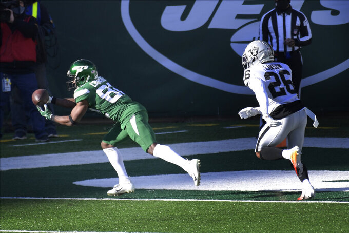 New York Jets' Jamison Crowder, left, catches a pass for a touchdown during the first half an NFL football game against the Las Vegas Raiders, Sunday, Dec. 6, 2020, in East Rutherford, N.J. (AP Photo/Bill Kostroun)