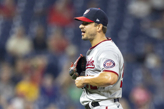 Washington Nationals closing pitcher Brad Hand reacts to the team's 6-4 win over the Philadelphia Phillies in a baseball game, Tuesday, July 27, 2021, in Philadelphia. (AP Photo/Laurence Kesterson)