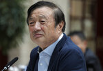 In this Tuesday, Jan. 15, 2019, photo, Ren Zhengfei, founder and CEO of Huawei, listens to reporters questions during a round table meeting with the media in Shenzhen city, south China's Guangdong province. China's government called on Washington on Tuesday to