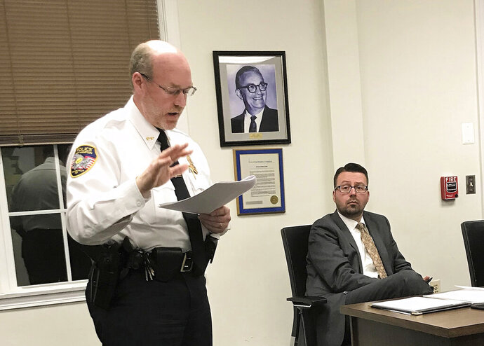 FILE - In this Nov. 14, 2018 file photo, East Hampton, Conn., Police Chief Dennis Woessner addresses the Town Council in East Hampton. East Hampton officer Kevin P. Wilcox, has retired from the force after Committee for Civil Rights Under Law raised concerns about his membership with the Proud Boys, a far-right group known for engaging in violent clashes at political rallies. In September, Woessner told the civil rights organization that Wilcox's Proud Boys membership didn't violate department policies. (Jeff Mill/The Middletown Press via AP)