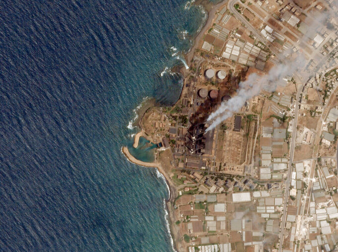 In this satellite photo from Planet Labs Inc., the Baniyas Thermal Station, a major oil refinery is seen in Baniyas, Syria, June 20, 2021. A massive oil spill caused by leakage from the power plant inside the oil refinery is spreading along the coast of the Mediterranean country, Syria's state news agency said and satellite photos showed Wednesday. (Planet Labs Inc. via AP)
