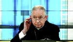 In this image taken from video, U.S. Conference of Catholic Bishops president and Los Angeles Archbishop José Gomez of Los Angeles confers with staff to alert the next speaker during their virtual assembly on Wednesday, June 16, 2021.(United States Conference of Catholic Bishops via AP)