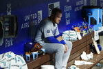 Los Angeles Dodgers' Max Muncy sits on the bench during a rain delay before the ninth inning of a baseball game against the Philadelphia Phillies, Tuesday, July 16, 2019, in Philadelphia. (AP Photo/Matt Slocum)
