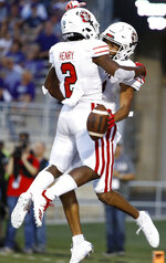 South Dakota wide receiver Dakarai Allen, right, celebrates with running back Kai Henry (2) after scoring a touchdown during the first half of an NCAA college football game against Kansas State Saturday, Sept. 1, 2018, in Manhattan, Kan. (AP Photo/Charlie Riedel)