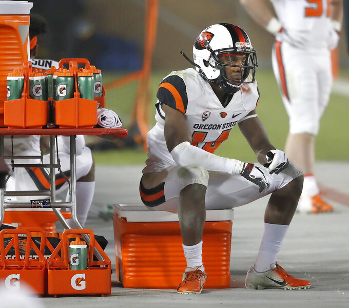Oregon State cornerback Kaleb Hayes (14) sits on the sidelines during the last minutes against Stanford in an NCAA college football game on Saturday, Nov. 10, 2018, in Stanford, Calif. Stanford won 48-17. (AP Photo/Tony Avelar)