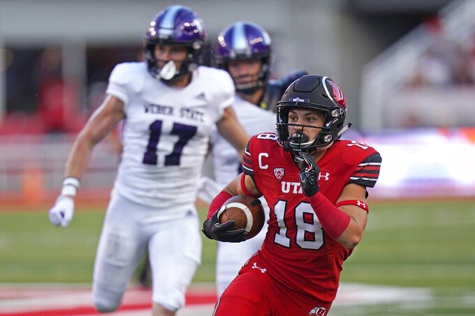 Utah wide receiver Britain Covey (18) carries the ball during the first half of the team's NCAA college football game against Weber State on Thursday, Sept. 2, 2021, in Salt Lake City. (AP Photo/Rick Bowmer)