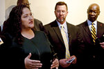 Sonya Pyles, left, a Women in Recovery Graduate and Advocate, speaks after a group working to reduce Oklahoma's prison population launched an initiative petition that could lead to the release of hundreds more inmates, Tuesday, Nov. 12, 2019, in Oklahoma City. (AP Photo/Sue Ogrocki)