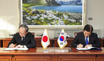 FILE - In this Nov. 23, 2016, file photo provided by South Korean Defense Ministry, South Korean Defense Minister Han Min Koo, right, and Japanese Ambassador to South Korea Yasumasa Nagamine sign the General Security of Military Information Agreement, or GSOMIA, an intelligence-sharing agreement between South Korea and Japan in Seoul, South Korea.Squeezed between a growing North Korean threat and a shaky alliance with the United States, South Korea must decide this week whether its national pride and deep frustrations with Japan are worth killing a major symbol of their security cooperation with Washington. (South Korean Defense Ministry via AP, File)