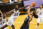 Missouri's Jeremiah Tilmon, left, blocks the shot of Oral Roberts' Kareem Thompson during the first half of an NCAA college basketball game Wednesday, Nov. 25, 2020, in Columbia, Mo. (AP Photo/L.G. Patterson)