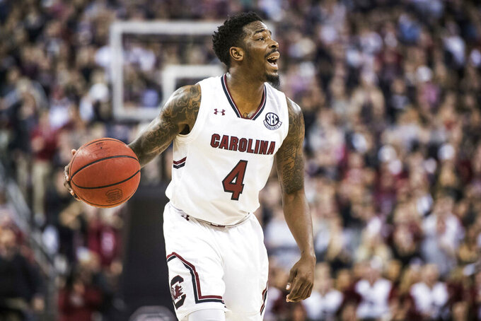 South Carolina guard Tre Campbell (4) communicates with teammates during the second half of an NCAA college basketball game Tuesday, Jan. 29, 2019, in Columbia, S.C. Tennessee defeated South Carolina 92-70. (AP Photo/Sean Rayford)