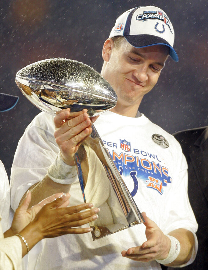 FILE - Indianapolis Colts' Peyton Manning (18) holds the Vince Lombardi Trophy after the Colts' 29-17 win over the Chicago Bears in the Super Bowl 41 NFL football game at Dolphin Stadium in Miami, in this Sunday, Feb. 4, 2007, file photo. Peyton Manning never wanted to leave Indianapolis. But when a neck injury forced him to miss a season and the Colts moved on to Andrew Luck, he couldn't have landed in a better place than Denver, where he produced a terrific second chapter to his Hall of Fame career. (AP Photo/Amy Sancetta, File)