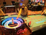 A dealer conducts a game of roulette at Bally's casino in Atlantic City N.J. , in this June 23, 2021, file photo. Eight of Atlantic City's nine casinos posted an operating profit in the second quarter of this year as business improved and gamblers were eager to return to gambling halls in person. Figures released Monday, Aug. 23, 2021, by the New Jersey Division of Gaming Enforcement show the casinos collectively posted a gross operating profit of $185.1 million in April, May and June of this year. (AP Photo/Wayne Parry)