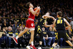Indiana forward Race Thompson, left, catches a pass next to Iowa's Connor McCaffery, center, and Nicholas Baer, right, during the first half of an NCAA college basketball game Friday, Feb. 22, 2019, in Iowa City, Iowa. (AP Photo/Charlie Neibergall)