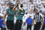 Coastal Carolina kicker Liam Gray (31) reacts after missing a field goal attempt during the first half of a NCAA college football game against Buffalo in Buffalo, N.Y. on Saturday, Sept. 18, 2021. (AP Photo/Joshua Bessex)