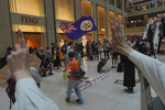 Protesters wave a Hong Kong colonial flag in a shopping mall during a protest against China's national security legislation for the city, in Hong Kong, Monday, June 1, 2020. The mouthpiece of China's ruling Communist Party says U.S. moves to end some trading privileges extended to Hong Kong grossly interfere in China's internal affairs and are doomed to fail. (AP Photo/Vincent Yu)