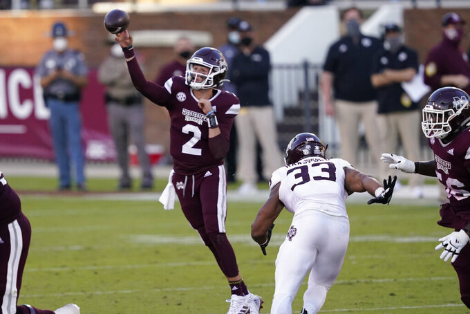 Mississippi State quarterback Will Rogers (2) passes under pressure from Texas A&M linebacker Aaron Hansford (33) during the second half of an NCAA college football game in Starkville, Miss., Saturday, Oct. 17, 2020. (AP Photo/Rogelio V. Solis)