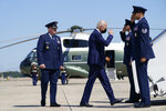 President Joe Biden returns a salute as he walks to board Air Force One to travel to Louisiana to view damage caused by Hurricane Ida, Friday, Sept. 3, 2021, in Andrews Air Force Base, Md. (AP Photo/Evan Vucci)