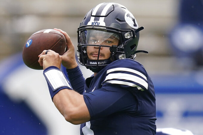BYU quarterback Jaren Hall warms up before an NCAA college football game against Boise State, Saturday, Oct. 9, 2021, in Provo, Utah. (AP Photo/Rick Bowmer)