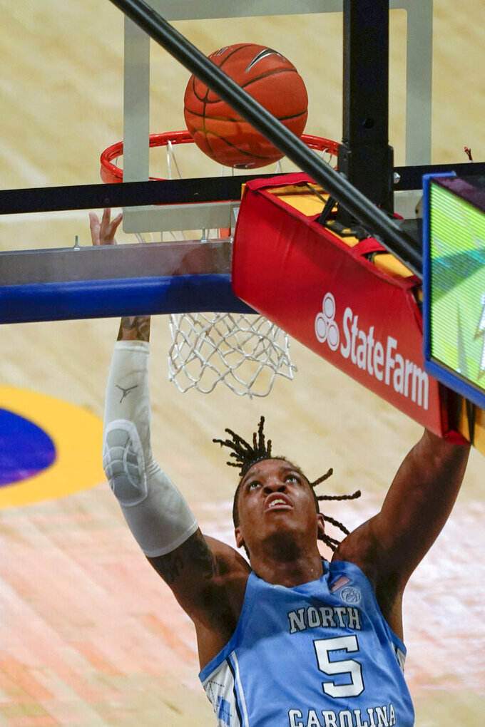 North Carolina's Armando Bacot scores against Pittsburgh during the first half of an NCAA college basketball game, Tuesday, Jan. 26, 2021, in Pittsburgh. (AP Photo/Keith Srakocic)