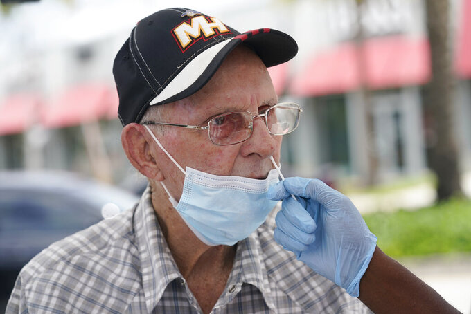 Alberto Rodriguez gets a COVID-19 rapid test, Monday, July 26, 2021, in Miami. Rodriguez needs a negative test to be able to visit his wife at a nursing home. Florida accounted for a fifth of the nation's new infections last week, more than any other state, according to the U.S. Centers for Disease Control and Prevention. (AP Photo/Marta Lavandier)
