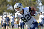 """FILE - In this July 29, 2019, file photo, Dallas Cowboys tight end Jason Witten runs the ball after a reception at the NFL football team's training camp in Oxnard, Calif. There's so much potential on offense that Witten left the """"Monday Night Football"""" broadcast booth after one year to return for his 16th season. (AP Photo/Michael Owen Baker, File)"""